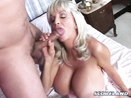 In this chapter of the SCORE Classic movie Tit Attack, Dee Dee Deluxx's dumb bastard husband has just left the house for a day of hard labor at the office while his accommodating housewife lounges around the house all day watching soaps on TV and waiting