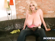 She loosens her top and her tits begin to escape their confinement as she keeps wiggling.