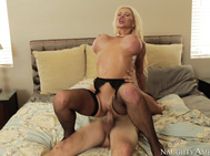 Nikita comes out of the bathroom in some sexy lingerie and begins to suck his cock.
