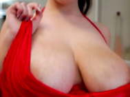 Angela white entertains us in the bathroom as she first tempts us with her luxurious 36g-28-41 body in a red negligee.