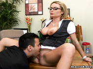 She was looking luscious behind her desk with those juicy jugs almost popping out.