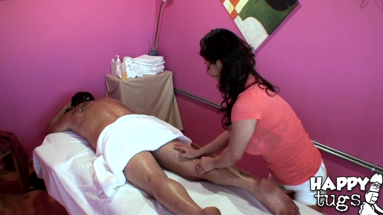 She uses her smooth hands to work her magic over her clients body and eventually wonders over to his cock.
