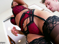 The amazingly beautiful August Ames looks mesmerizing in her sexy lingerie.