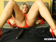She loves porn, thinks it's fun and has immersed herself in it, making regular trips to SCORE for cock or toy action.