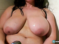 In this boner-making Bonus scene, Ann Calis body-gels her tasty cakes and her poozie in the models' dressing room, then aims a shower head in her direction.