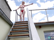 If this were New York City or Chicago, an uptight citizen with high-powered binoculars would have probably complained when the ivory-skinned blonde lowered her bikini top and kept her big tits hanging out.