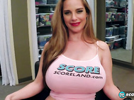 Desiree Vega wears the SCORE model uniform pink tank top and pink thong panties in the dressing room between shoots.