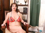 MILF of the Month Elektra was a 43-year-old with big DD boobs and a super-thick bush when she made this video.