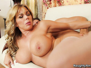 Out comes his hard dick, and on it the blonde cougar pounces.