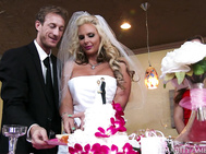 Phoenix and Ryan just got married and are about to slice their wedding cake.