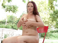 Im talking about none other than joanna bliss, this time sitting around on a patio, sliding out of a low-cut blouse, flower-print bra to dazzle our eyes with her 36h rack.