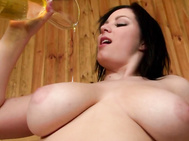 Leaning back on the bench, she pours oil on her rack until she