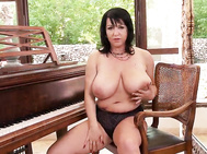 The polish beauty starts her scene wearing a very flattering black bra, high-waisted panty set.