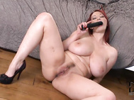 Taking out a black dildo even as she lowers the front of her garment, she displays those mouthwatering 34dd glands, pressing them together as our ddf lenses come close to capture the surface of her massive nipples.