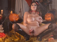 Like the devilish pumpkins that surround her in the dramatically lit party room, sensual jane is up to mischief.