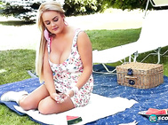 Leaning over the terrace railing, she sees fellow British bra-buster Michelle Bond lying on a huge trampoline.