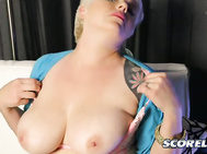 Missy Monroe wears a denim mini-skirt and a nice and tight button-down cardigan that shows belly. 2